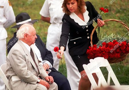 "ROONEY Veteran actor Mickey Rooney is handed a red carnation to be placed on the crypt of the late actor Douglas Fairbanks Jr. during a memorial service, Wednesday, May 24. 2000, at the Hollywood Forever Cemetery in Los Angeles. Fairbanks Jr., whose film work included ""Gunga Din"" and ""Sinbad the Sailor,"" died on May 7 in New York"