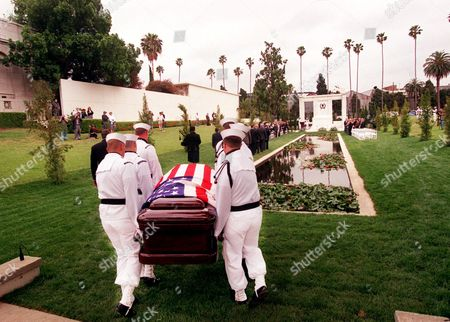 "DOUGLAS FAIRBANKSJR A United States Navy Honor Guard carry the casket of the late actor Douglas Fairbanks Jr. for a burial service at the Hollywood Forever Cemetery in Los Angeles, . Fairbanks, star of such films as ""Gunga Din"" and ""Sinbad the Sailor,"" also was awarded numerous medals for his U.S. Navy service in World War II"