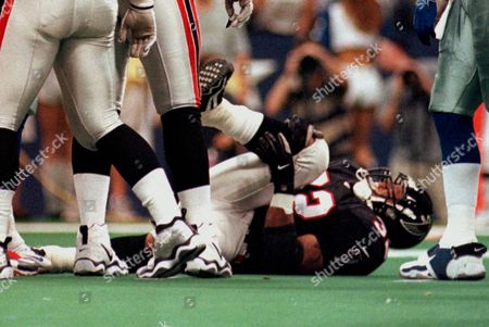 ANDERSON Atlanta Falcons All-Pro running back Jamal Anderson holds his right knee after hurting it in the first quarter of the Falcons' 24-7 loss to the Dallas Cowboys in Irving, Texas. Anderson tore the anterior cruciate ligament in his right knee, going down without being touched on his third carry of the game and will be out for the rest of the season