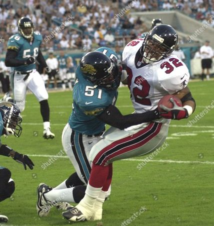 ANDERSON HARDY NICKERSON Atlanta Falcons' Jamal Anderson is taken down by Jacksonville Jaguars' Kevin Hardy as Jags' Hardy Nickerson, left, moves towards the play in the first quarter of their preseason game in Jacksonville, Fla
