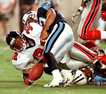 ANDERSON, KEARSE, ROBERTSON Atlanta Falcons running back Jamal Anderson (32) fumbles the ball after being hit by Tennessee Titans' Jevon Kearse, bottom right, and Blaine Bishop, in Nashville, Tenn. Tennessee's Marcus Robertson recovered the ball