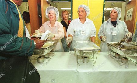 DIXON DEGROSS WASHINGTON From left, volunteer workers Rita Dixon, Julia DeGross and Sharon Washington serve up Thanksgiving dinner for the needy, in Baltimore. The dinner is an annual event started by homeless advocate Bea Gaddy