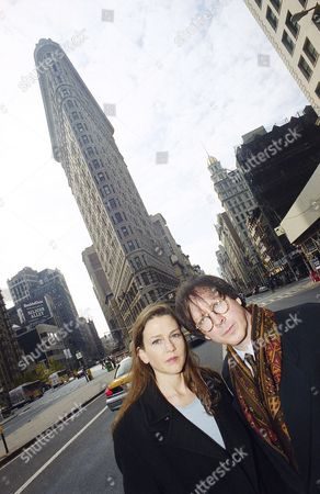 """Ric Burns, Lisa Ades Filmmakers Ric Burns and Lisa Ades pose in front of New York's Flatiron Building, . The building is among those featured in """"New York: A Documentary Film,"""" produced by Burns and Ades for PBS. Burns also directed and helped write the documentary"""