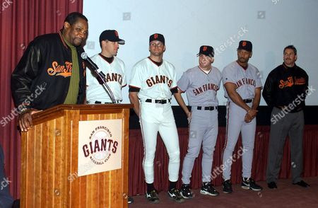 GIANTS San Francisco Giants manager Dusty Baker, left, introduces, from left, first baseman J.T. Snow, pitcher Shawn Estes, third baseman Bill Mueller, right fielder Ellis Burks, and coach Ron Wotus during a new uniform launch in San Francisco, . With a move to a new ballpark next season, the Giants are returning to a style reminscent of the classic Giants uniforms of the 1950s and 60s