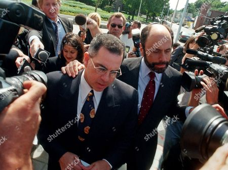 "GOTTI John ""Junior"" Gotti, left, moves through the crowd after drawing a 77-month sentence in White Plains, N.Y., . Gotti had pleaded guilty in April to charges of bribery, extortion, gambling and fraud. If convicted at his trial Gotti faced up to 15 years and millions of dollars in fines"