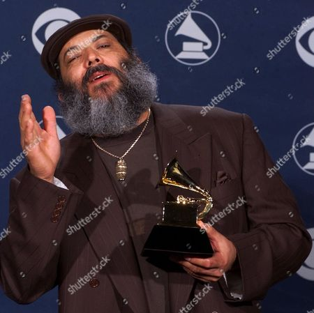 SANCHEZ Poncho Sanchez reacts after winning the Grammy for best Latin jazz performance for his Latin Soul album during the 42nd Grammy Awards in Los Angeles