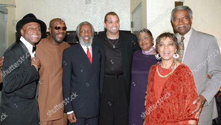 DAVIS Michael Colyar, far left, Issaic Hayes, Dick Gregory, Sinbad, Lillian Gregory, Ruby Dee and Ozie Davis, far right, pose for a photograph during a gathering to honor civil rights pioneer and comedian Dick Gregory, 3rd from left, at the Kennedy Center, in Washington Monday Oct. 9,2000