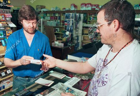 "TOWERY Andy Peebles, right, buys a lotto ticket from employee Brett Towery at Nau's Enfield Drugstore in Austin, Texas on . Nau's recently sold a winning lotto ticket worth $28 million to former Dallas Cowboy player Thomas ""Hollywood"" Henderson"