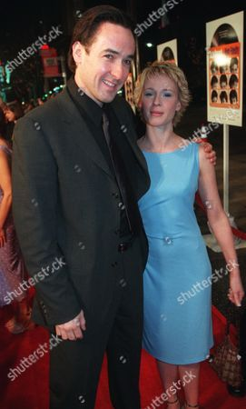 """CUSACK HJEJLE Actors John Cusack and Iben Hjejle, who star in the new film """"High Fidelity,"""" pose together on the red carpet at the premiere of the film, at the El Capitan Theater in the Hollywood section of Los Angeles"""