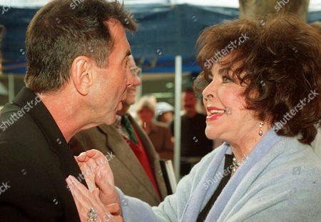 TAYLOR GALLIN Actress Elizabeth Taylor chats with friend Sandy Gallin following a ceremony for award-winning songwriter Carole Bayer Sager honoring Sager with a star on the Hollywood Walk of Fame in Los Angeles