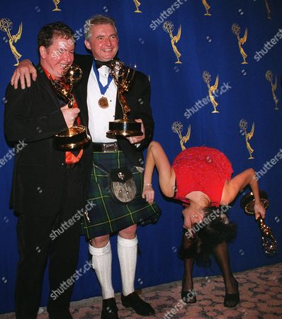 "JOHNSON ACKERMAN ALLEN While meeting the press backstage with fellow prize winners at the 27th Annual International Emmy Awards, actress Fiona Allen seems more interested in what's under director Graham Johnson's kilt than the media gathered in front of them Monday night, in New York. Johnson and Roy Ackerman, left, won International Emmys for their Arts Documentary ""The Phil - Part 3,"" about the London Philharmonic while Allen won for her performance in ""Smack the Pony,"" a show of uninhibited sketches. Both winning shows were products of the UK"