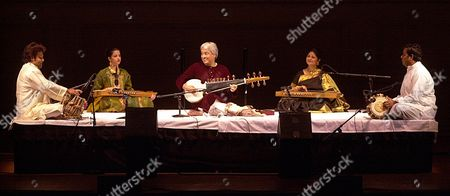 GANGANI Maestro Amjad Ali Khan, center, is assisted by his sons Amaan Ali Bangash and Ayaan Bangash as they perform at Carnegie Hall in New York. They are accompanied by Tanmoy Bose on the Tabla and Fateh Singh Gangani on the Pakhawaj