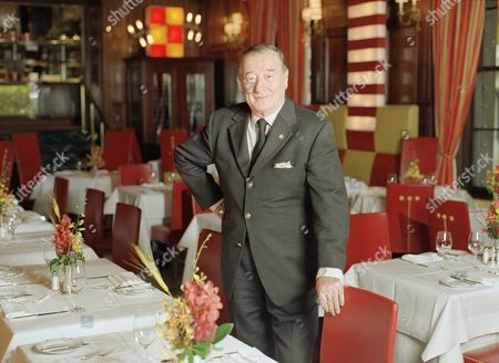"""Restaurateur Sirio Maccioni, owner of Le Cirque 2000 stands inside the celebrated French restaurant in New York, . Le Cirque is the dining room of the rich and famous, """"We were sold out from the first day with famous names,"""" says Maccioni, who opened Le Cirque in 1974 in the Mayfair Hotel on the Upper East Side. The restaurant is now located in the landmark Villard Houses in midtown Manhattan"""