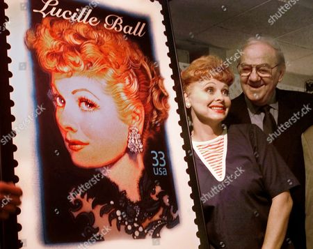 BALL MALDEN LARUSCH Actor Karl Malden and Lucy impersonator Suzanne Larusch pose with a large portrait of a new postage stamp honoring the late actress and comedienne Lucille Ball after its unveiling, in Burbank, Calif. The stamp, due to be issued in 2001, is the seventh in the Legnds of Hollywood series that has previously honored Marilyn Monroe, James Dean, Humphrey Bogart, Alfred Hitchcock, James Cagney and Edward G. Robinson. Malden is participating as a member of the Citizens' Stamp Advisory Commmittee