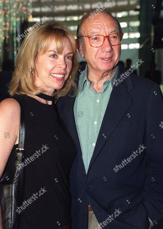 SIMON JOYCE Neil Simon and his wife Elaine Joyce smile at photographers as they arrive at a memorial service for actor Walter Matthau, in the Hollywood section of Los Angeles. Matthau died of a heart attack last month at the age of 79. Guests at the memorial included cast members from many of Matthau's films