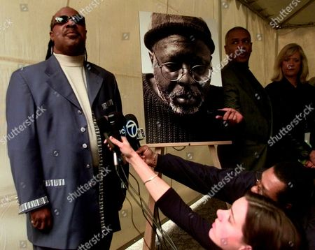 Stock Photo of WONDER Singer Stevie Wonder, left, talks with reporters prior to a memorial service for songwriter-vocalist Curtis Mayfield in Los Angeles on . Mayfield died on Dec. 26, 1999, after a prolonged illness that stemmed from a freak accident at a concert in 1990