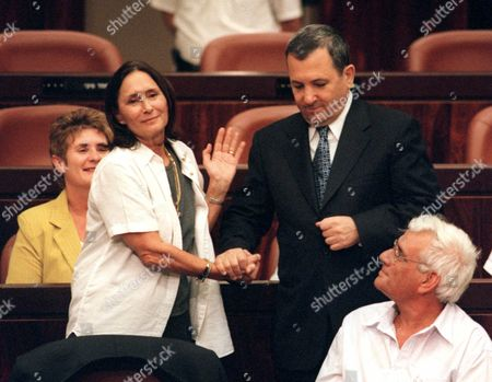 BARAK DAYAN Israeli Prime Minister Ehud Barak, shakes hands with Knesset member Yael Dayan, daughter of Moshe Dayan, following her critical speech at the Knesset, Israel's parliament, in Jerusalem . In the dramatic speech, Dayan criticized Barak for not appointing her to the newly-expanded Cabinet, thus not recognizing her high standing in the Labor Party. Dayan also called on Barak to follow in the steps of Moshe Dayan and Yitzak Rabin, both military men who forwarded peace in the region