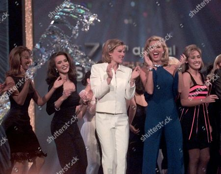 MISS AMERICA Miss America hopefuls dance during the opening of the finals in the Atlantic City Convention Hall in Atlantic City, N.J., . Left to right: Miss Michigan, Audrie Chernauckas; Miss West Virginia, Lucy Ours; Miss New Jersey, Victoria Paige; Miss Tennessee, Allison Alderson; Miss Virginia, Crystal Lewis