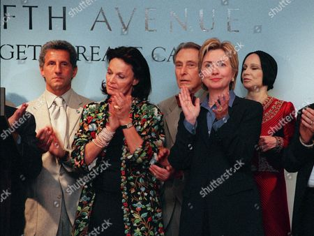 """CLINTON Designers Joseph Abboud, left, Diane Von Furstenberg, second left, Herbert Kaspar, third left, and Mary McFadden, right, join first lady Hillary Rodham Clinton at Saks Fifth Avenue in New York to kick off the """"Fashion Targets Breast Cancer"""" benefit Wednesday, Sept, 22, 1999"""