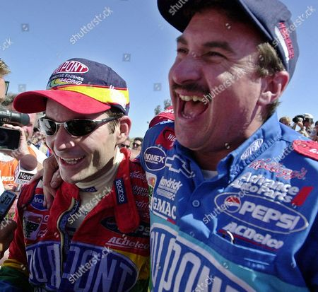 GORDON LOOMIS Jeff Gordon, left, shares a laugh with crew chief Robbie Loomis after winning the NASCAR Save Mart 350 race, at Sears Point Raceway near Sonoma, Calif. This is Gordon's sixth consecutive road course win