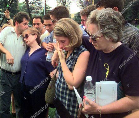 QUINN Michael Quinn, left, kisses his mother Marie Quinn, as his sister Colleen wipes away a tear and is embraced by an unidentified woman outside the Atlanta office building where his father, Edward Quinn, was shot and killed when a gunman opened fire last Thursday. Nine people were killed in two offices buildings and police discovered the bodies of the suspects' wife and two children dead in their home a few hours later.The suspect, Mark O. Barton, killed himself after being pulledover by police that night