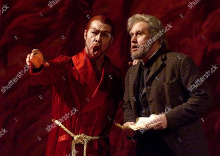 """RAMEY LEECH Devilish Samuel Ramey, left, in the title role of Mefistofele, and Richard Leech, as Faust, sing during, rehearsal at New York's Metropolitan Opera. Ramey made the Metropolitan Opera bring back """"Mefistofele"""" after an absence of 75 years"""