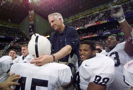 Jerry Sandusky This Dec. 28, 1999 photo shows Penn State defensive coordinator Jerry Sandusky reaching out to defensive back Brandon Scott (45) as he is carried by players including Jason Wallace (88) after they defeated Texas A&M in the Alamo Bowl, in San Antonio, Tex. Investigators on encouraged anyone who would accuse Sandusky of sexual assault to step forward and talk to police. Sandusky was arrested Saturday on charges that he preyed on boys he met through The Second Mile, a charity he founded for at-risk youths