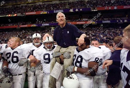 Jerry Sandusky This photo shows Penn State defensive coordinator Jerry Sandusky being carried by players Rick Bolinsky (92), center left, and Jason Wallace (88) after they defeated Texas A&M in the Alamo Bowl, in San Antonio, Tex. The NCAA has slammed Penn State with an unprecedented series of penalties, including a $60 million fine and the loss of all coach Joe Paterno's victories from 1998-2011, in the wake of the Jerry Sandusky child sex abuse scandal