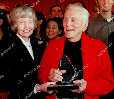 """TRACY DOUGLAS Actor Kirk Douglas poses with Susie Tracy, the daughter of the late Spencer Tracy, after Douglas was honored with the 11th annual Spencer Tracy Award at the University of California, Los Angeles in Los Angeles . The award is presented for outstanding achievement in drama. Douglas, who suffered a stroke four years ago, appears in the December release of the Miramax film """"Diamonds"""