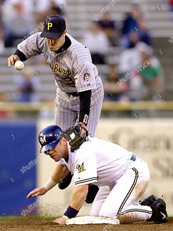 MORRIS JENKINS Pittsburgh Pirates second baseman Warren Morris drops the ball as Milwaukee Brewers' Geoff Jenkins breaks up a double play in the fourth inning, in Milwaukee. Brewers' Charlie Hayes was safe at first