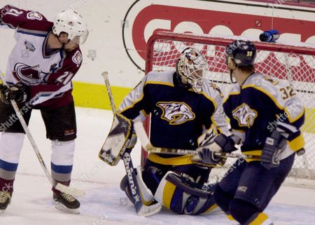 HULSE Colorado Avalanche center Peter Forsberg, left, scores the winning goal past Nashville Predators goalie Mike Dunham, back right, as defenseman Cale Hulse, front right, look on in the Avalanche's 2-1 overtime victory in Denver's Pepsi Center on