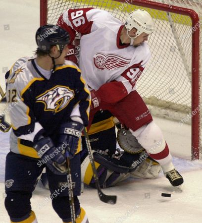 HOLMSTROM Detroit Red Wings Tomas Holmstrom (96) tries to redirect the puck past Nashville Predators goalie Mike Dunham as Cale Hulse (32) looks on in the second period at Joe Louis Arena in Detroit, . The Predators won 2-1 in overtime