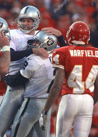 NEDNEY ARAGUZ WARFIELD Oakland Raiders kicker Joe Nedney, left, is congratulated by holder Leo Araguz (2) after kicking the game-winning field goal in overtime in Kansas City, Mo. Chiefs cornerback Eric Warfield (44) walks off the field after the kick. The Raiders defeated the Chiefs 41-38