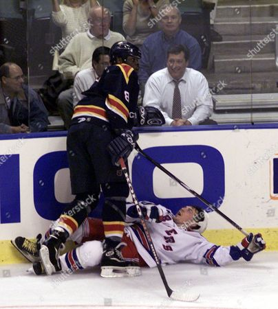 WORRELL JOHNSON Florida Panthers' Peter Worrell (8) checks New York Rangers' Theo Fleury (3 ) in the first period, at the National Car Rental Center in Sunrise, Fla