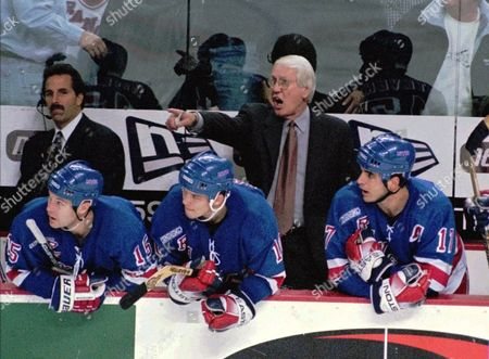 MUCKLER New York Rangers coach John Muckler yells instructions to his players on the ice during the third period against the Buffalo Sabres at Marine Midland Arena in Buffalo, N.Y., on . Looking on are John MacLean (15), Todd Harvey (10), and Kevin Stevens (17