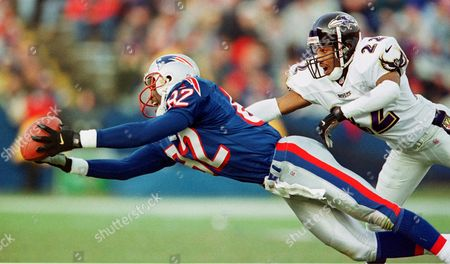 BRISBY STARKS New England Patriots wide receiver Vincent Brisby (82) makes a diving catch against Baltimore Ravens defender Duane Starks (22) during the second half at Foxboro Stadium in Foxboro, Mass. . The Patriots went on to win, 20-3
