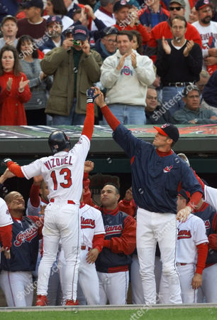 VIZQUEL SEXSON Omar Vizquel (13) gets a high high-five from Cleveland Indians teammate Richie Sexson after scoring in the third inning against the Boston Red Sox at Jacobs Field in Cleveland. Vizquel tripled to drive in two runs off Boston's Bret Saberhagen. Vizquel scored on teammate Roberto Alomar's double