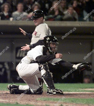 BROGNA JOHNSON Boston Red Sox' Rico Brogna scores from third on a sacrifice fly by teammate Mike Lansing as Chicago White Sox' catcher Mark Johnson waits for the throw in the eighth inning in Chicago. Brogna's run put the Red Sox ahead and they won the game 7-6