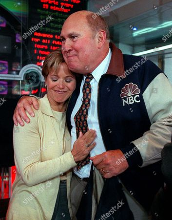 "COURIC SCOTT Willard Scott, right, hugs Today show colleague Katie Couric after a ceremony inducting Scott into NBC's ""Walk of Fame"" at the NBC Experience Store in New York . This year marks Scott's 50th anniversary with NBC"