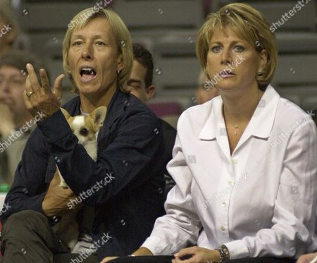 LIEBERMAN-CLINE NAVRATILOVA Detroit Shock head coach Nancy Lieberman-Cline, right, watches her team against the Miami Sol as former tennis star Martina Navratilova questions a officials call in the second half at the Palace of Auburn Hills, Mich. The Shock won, 78-62. Navratilova, who held her dog Bino during the entire game, tossed the honorary jump ball before the game