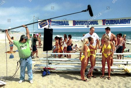 """VESPOINT Boom operator Don Vespoint records the main cast of the """"Baywatch"""" television parody """"Son of the Beach"""" as they perform a scene, at Will Rogers State Beach in Santa Monica, Calif. Clockwise from top left in the group of five are actors Timothy Stack, Roland Kickinger, Kim Oja, Leila Arcieri and Jaime Bergman"""