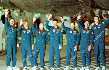 SMITH The crew of the space shuttle Discovery, left to right, Curt Brown, Claude Nicollier, of Switzerland, Scott Kelly, C. Michael Foale, Jean-Francois Clervoy, of France, John Grunsfeld, and Steve Smith stand under the shuttle and wave to a gathering on the shuttle landing strip at Kennedy Space Center, Fla., . The crew landed at the facility after an eight-day mission, the second repair mission to the Hubble Space Telescope