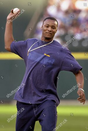 RASHARD LEWIS Seattle SuperSonics' Rashard Lewis tosses out the ceremonial first pitch before the Seattle Mariners game against the Boston Red Sox in Seattle