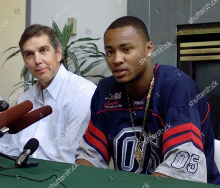 LEWIS WALKER Seattle SuperSonics coach Wally Walker, left, listens as Rashard Lewis talks to the press about why he signed with the SuperSonics, in Seattle. Lewis, a 6-foot-10 forward and occasional starter for the SuperSonics, signed a three-year contract worth $13.3 million