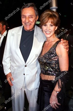 """BLAIR BLATTY Star of """"The Exorcist,"""" film Linda Blair, right, and producer, author of the novel and Oscar-winning screenplay, William Peter Blatty, pose for photographers as they arrive to a special screening of the re-released Warner Bros. Pictures' film with re-mastered sound and restored original footage, in Los Angeles"""
