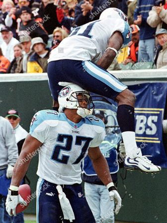 GEORGE SANDERS Tennessee Titans receiver Chris Sanders (81) leap-frogs over the top of running back Eddie George (27) after George scored on a 5-yard touchdown run in the third quarter against the Cincinnati Bengals, in Cincinnati. George ran for 181 yards as Tennessee won 23-14