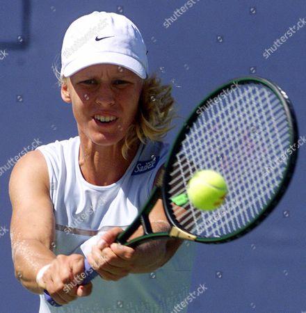 DEMENTIEVA Unseeded Elena Dementieva, of Russia, returns the ball to tenth seed Anke Huber, of Germany, at the U.S. Open tennis tournament, in New York. Dementieva upset Huber 6-1, 3-6, 6-3
