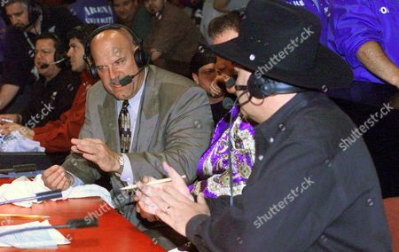 """VENTURA LAWLER ROSS Minnesota Governor Jesse Ventura, left,talks with commentators Jerry Lawler, center and Jim Ross during the World Wrestling Federation's """"Raw is War"""" event at the Allstate Arena, in Rosemont, Ill. The former wrestling star flew from St. Louis, the site of the governors' gathering, to promote his appearance later this month as a guest referee at a WWF title match"""