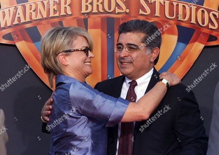 BERGEN DALY Actress Candice Bergen gives a big hug to Warner Bros. co-chief executive officer Terry Semel, right, following a cement ceremony outside Mann's Chinese theather in the Hollywood section of Los Angeles, . Robert A. Daly and Semel put their hand and footprints in the historic cement as they prepare to leave Warner Bros. after serving for nearly two decades as the company's leaders