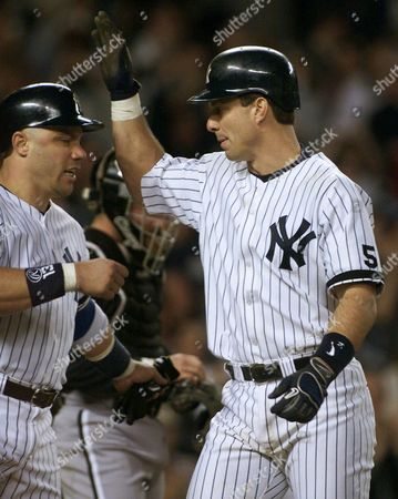 MARTINEZ LEYRITZ New York Yankees Tino Martinez, right, is congratulated with Jim Leyritz after Martinez hit a two-run home run in the third inning against the Chicago White Sox at Yankee Stadium in New York